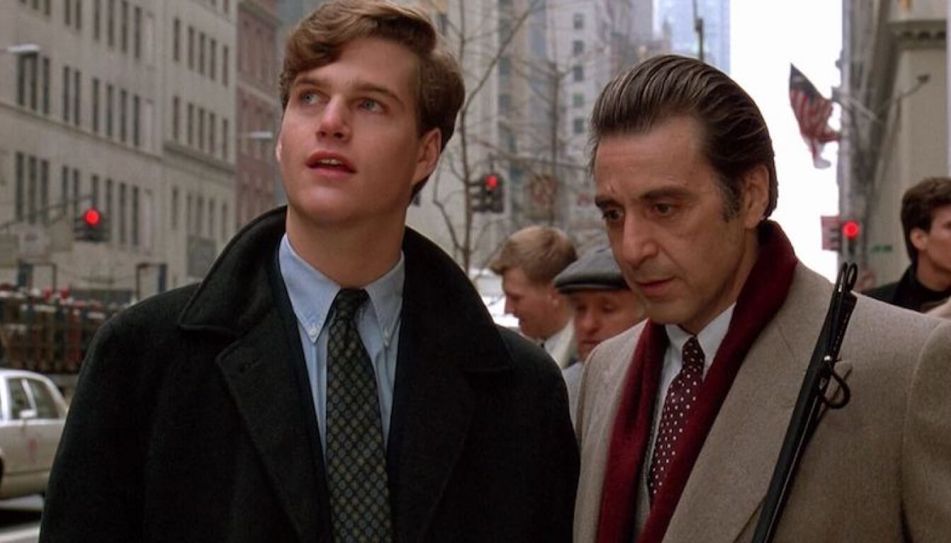 Screenshot from the move Scent of a Woman. The characters Frank Slade (Al Pacino) and Charlie Simms (Chris O'Donnell) standing next to each other on a New York street.